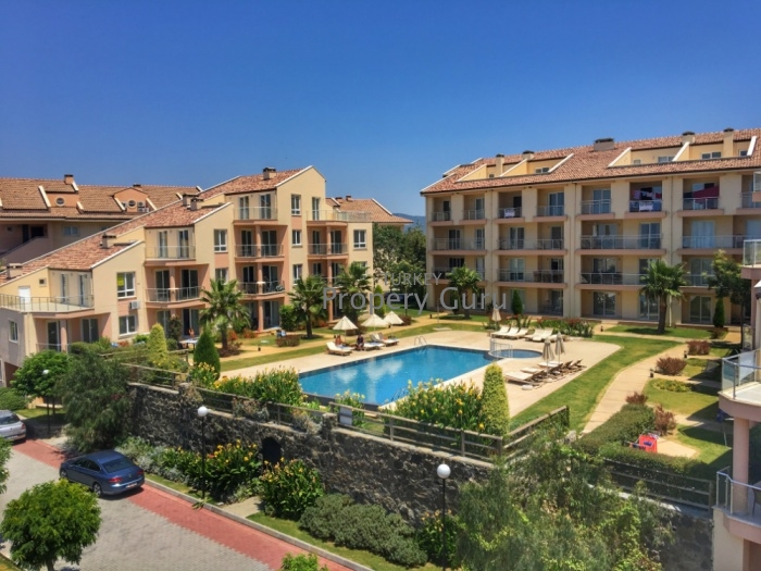 sea and pool view aprtment at golf in kusadasi for sale